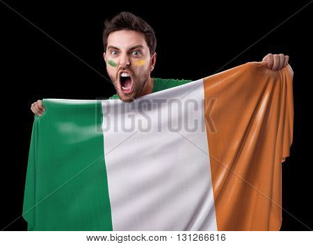 Fan holding the flag of Ireland