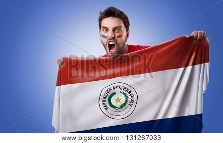 Fan holding the flag of Paraguay