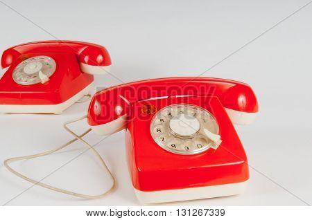 Retro Orange Telephone With Rotary Dial On White
