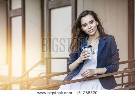 Beautiful Young Fashion Gir With Take-away Coffee In Hand