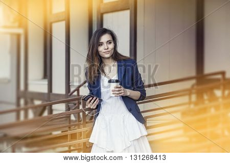 Beautiful Young Fashion Gir With Take-away Coffee In Hand And Smartphone