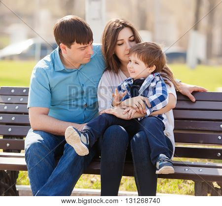 young parents and little son in the park