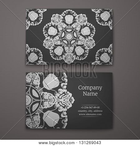 Black business card with flower and Ornaments in Baroque Style.
