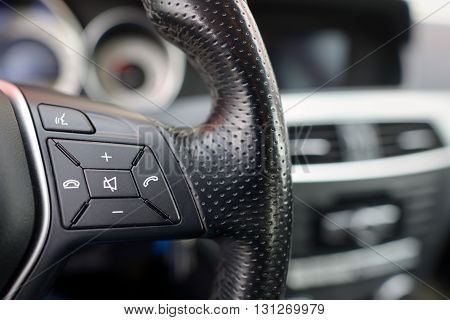 Steering wheel of modern car details of phone adjustment controls