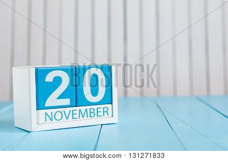 November 20th. Image of november 20 wooden color calendar on blue background. Autumn day. Empty space for text.