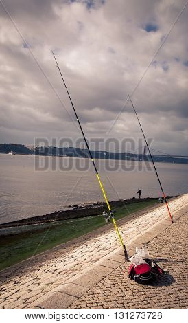 Fishing pole and reel on the banks of the Tagus River