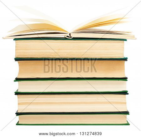 Stack of books with open one isolated on white background