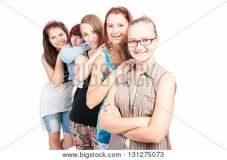 Group of teen girls smiling isolated on white background