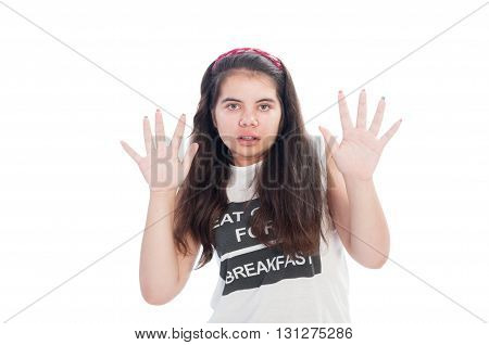 Girl beeing afraid and raising her hands
