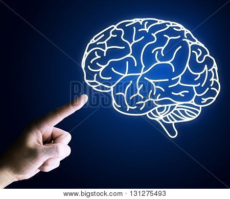 Human hand pointing with finger at brain icon on blue