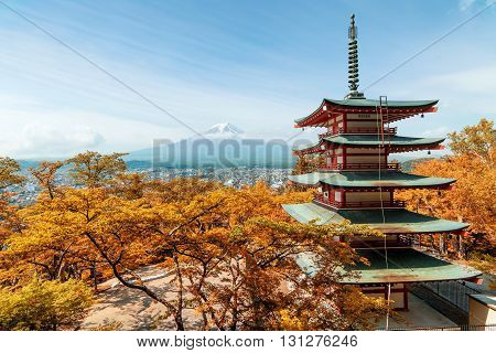 Travel in Japan - Beuatiful autumn in Japan at Red pagoda with Mt. Fuji in background Japan.