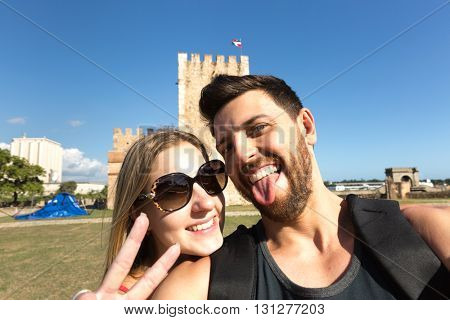Couple taking selfie at Ozama Fortress in Santo Domingo, Dominican Republic