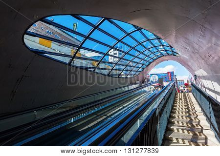 Eindhoven Netherlands - April 12 2016: escalator to a bicycle parking with unidentified people. With about 225000 inhabitants its the 5th-largest municipality of the Netherlands