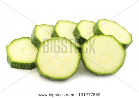 courgette slices on a white background
