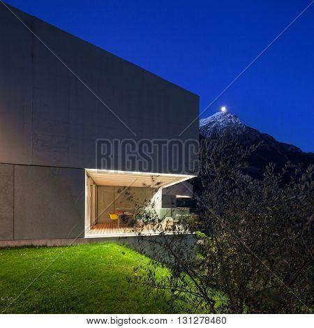 Architecture modern design, concrete house, lit terrace at night
