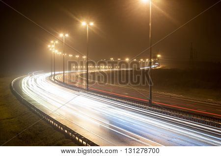 View Of The Night Route With Traces Headlights Cars