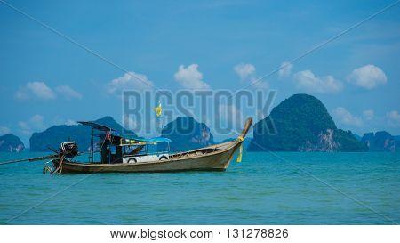 Long Tail Boat cruising on Andaman sea