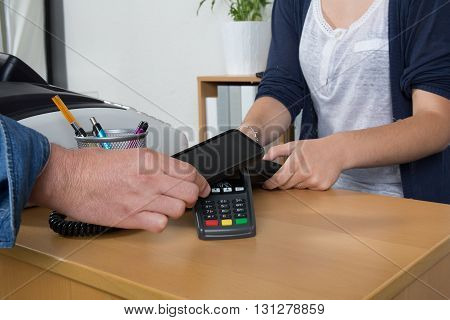 Man Paying With Nfc Technology On Credit Card With Phone, In Restaurant, Store,