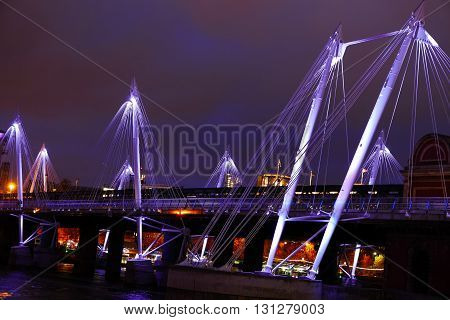 Illuminated Golden Jubilee Bridge At Night