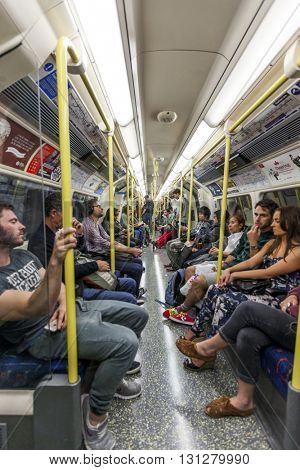 LONDON, UK - AUG 24, 2014: People sitting on an underground train in London during rush hour.