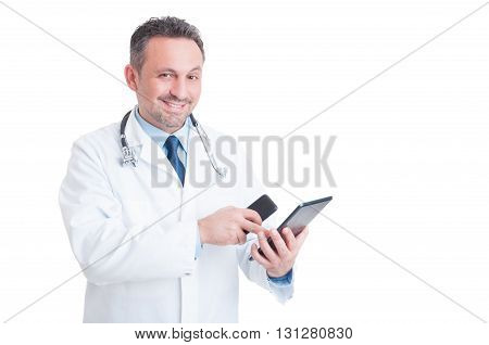 Busy Medic Or Doctor Using Tablet And Phone