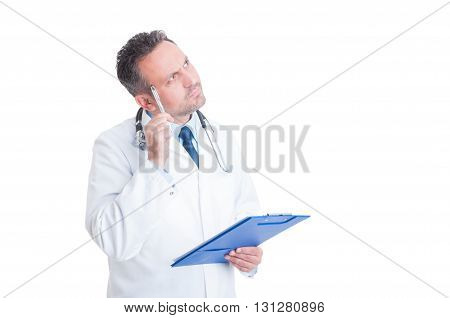 Smart Doctor Or Medic Holding Clipboard And Thinking