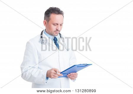 Smart Doctor Or Medic Analyzing Document On Clipboard