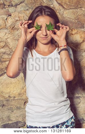 Cute Slim Female With Illegal Hemp Leaves At Her Eyes