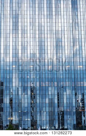 detail of a glass facade of a highrise