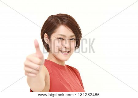young Japanese woman with thumbs up gesture