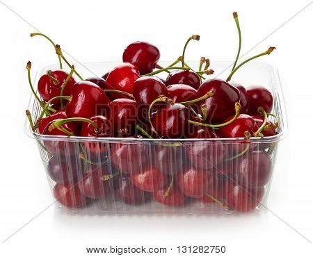 Cherry In Plastic Container Box Isolated On White