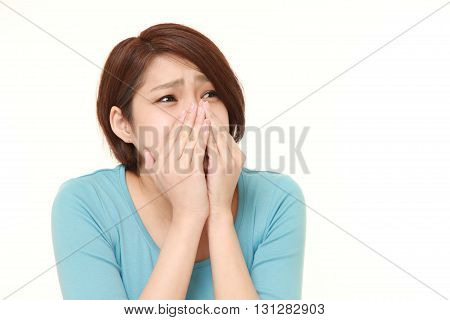 studio shot of frightened woman on white background