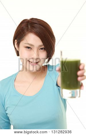 studio shot of Japanese woman with green vegetable juice on white background