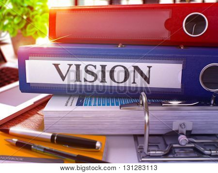 Vision - Blue Ring Binder on Office Desktop with Office Supplies and Modern Laptop. Vision Business Concept on Blurred Background. Vision - Toned Illustration. 3D Render.