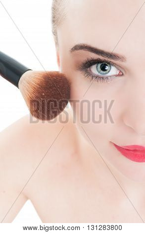 Close-up With Woman Using Make-up Brush