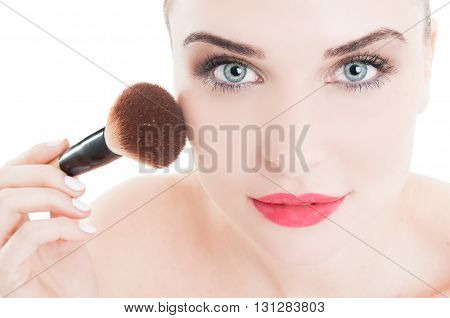 Woman Using Make-up Brush On Face Cheeks