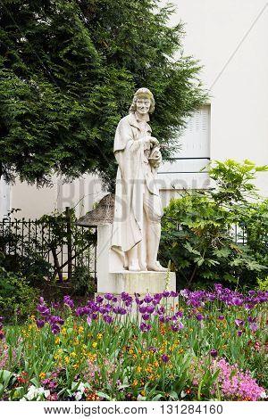 Voltaire's Statue in the garden Honoré Champion at 6th Arrondissement of Paris