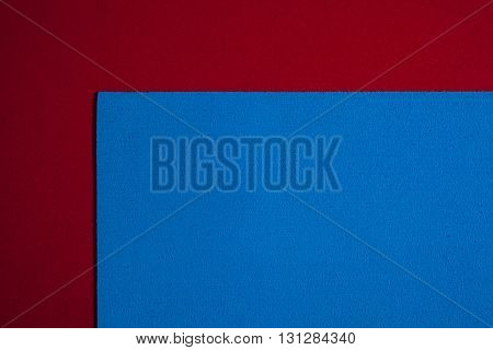 Eva foam ethylene vinyl acetate sponge plush blue surface on red smooth background