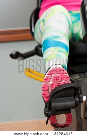 Close-up Of Female Leg Wearing Sport Shoe And Pedaling