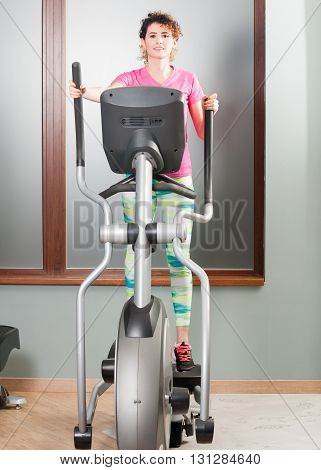 Beautiful Woman Training And Exercising On Stepper