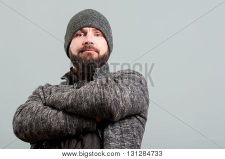 Attractive Bearded Man Standing With Arms Crossed