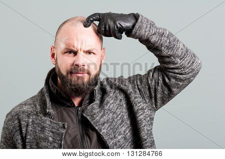 Young Man With Real Beard Scratching Head And Frown