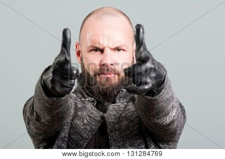 Close-up Of Handsome Guy With Beard Pointing Fingers
