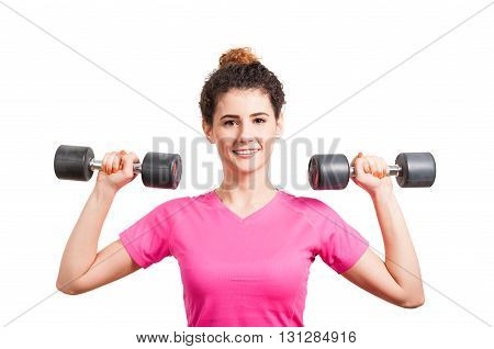 Fit Young Woman Training Her Deltoids With Barbells