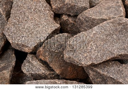 Close-up of natural gray rough stone used in sauna for decoration and making steam