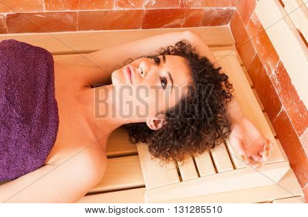 Close-up Of Woman Portrait While Relaxing On Bench