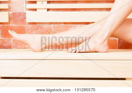 Close-up Of Woman Legs Resting On Bench In Sauna