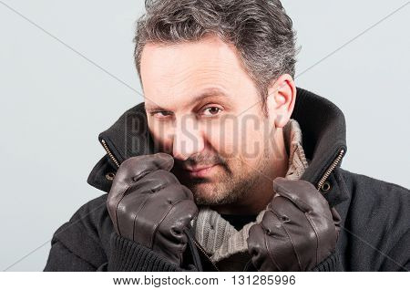 Close-up Of Handsome Male In Black Jacket And Leather Gloves