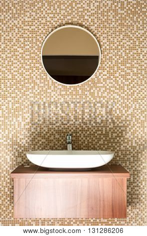 Round Mirror With Ceramic Sink And Silver Tap
