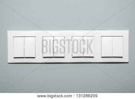 Close-up Of Multiple Light Switches On Blue Background
